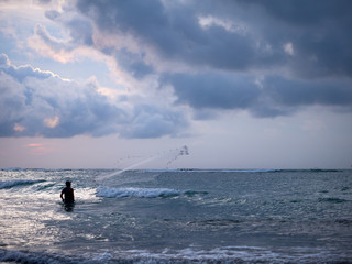 Fisherman on the beach of Kuta in Bali