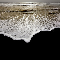 Strand with dark sand