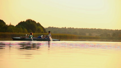 Man and woman paddling boat synchronously. Team-building, sport