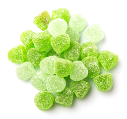 Green colored sugar jelly candy over white background