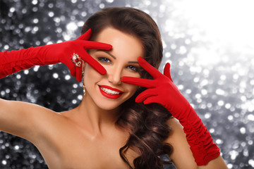 gay glamorous girl in red gloves and jewelry