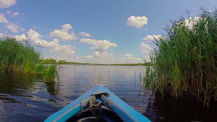 Boating on wide river, beautiful nature. Traveling, tourism, POV