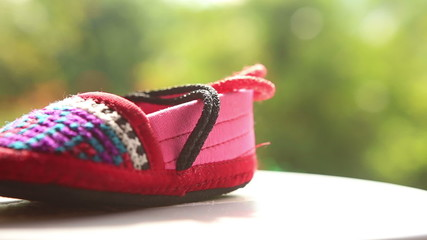 knitted baby shoes with embroidered national with ties
