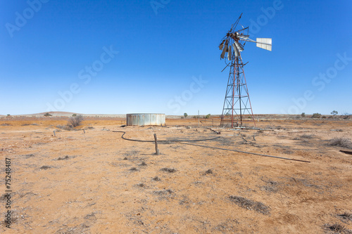 Fotobehang Woestijn Windmill on abandoned farm in outback Australia.
