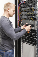 IT engineer builds network rack in datacenter