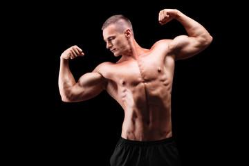 Male muscular bodybuilder posing