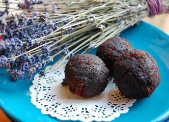 dark chocolate truffles with lavender on a dessert plate