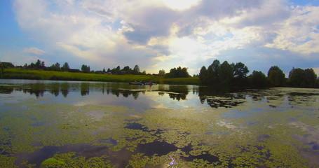 Beautiful river landscape, tourists kayaking, summer, traveling