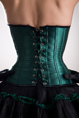 Rear view of attractive woman in green corset