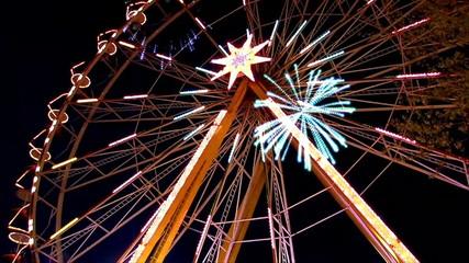 Fairground at night in city