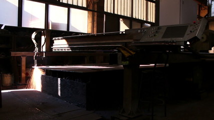 Heavy industry - The industrial laser cuts a metal sheet