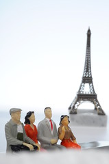 Miniature figures in front of Eiffel tower