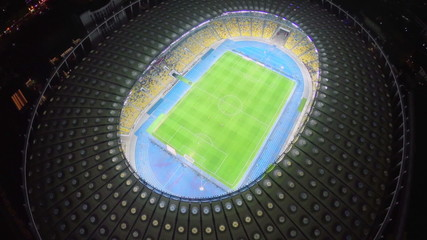 Soccer players on the stadium field, football match, aerial view