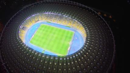 Vertical view of football field at beautiful stadium, aerial