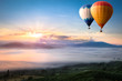 Leinwanddruck Bild - Hot air balloon over sea of mist