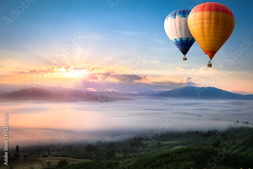 Leinwanddruck Bild Hot air balloon over sea of mist