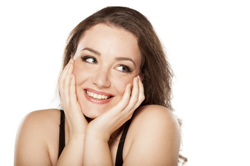 happy and smiling young woman on a white background