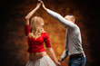 Leinwandbild Motiv Young couple dances Caribbean Salsa