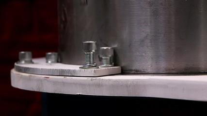 Man tightening a bolt using a screwdriver