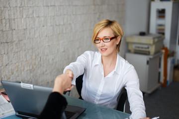 Confident businesswoman make contract
