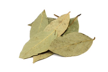 some dried bay leaves on a white background