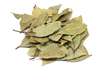 handful of dried bay leaves on a white background