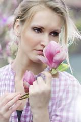 Beautiful girl with magnolia