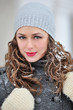 beautiful woman in winter with snow on the hair