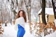 happy beautiful woman walking in winter