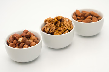 Mix of nuts in the bowls