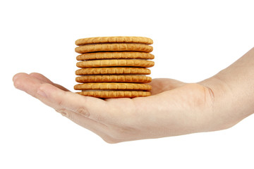 Stack of biscuits in woman hand isolated on white background