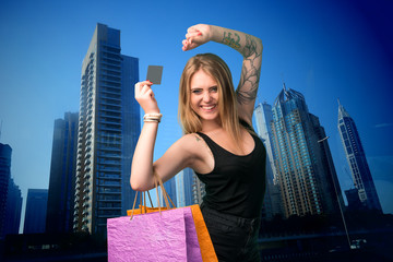 Young woman holding shopping bags