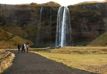 people at seljalandsfoss waterfall