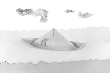 paper boat in a white paper sea