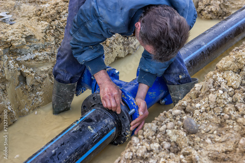 Close up of installing water pipe valve 3 - 75273800
