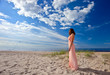 woman in pink dress on seacoast