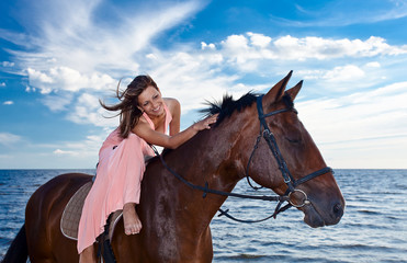 beautiful womanl with horse on seacoast