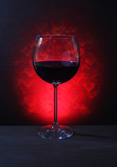 Glass of Red Wine with Lights Background