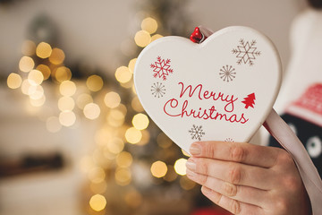 Christmas heart shaped toy in woman hands