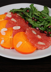 Salad of grapefruit, persimmon, pomegranate and rocket salad