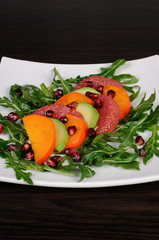 Salad with avocado, grapefruit, persimmon
