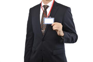 ネームプレートを付けている男性のビジネスマン