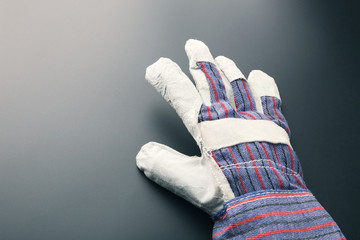 Work glove against grey