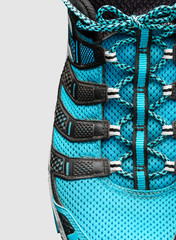 Closeup of  blue shoelaces on grey