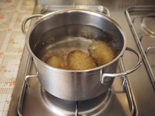 Saucepot with potatoes on cooker