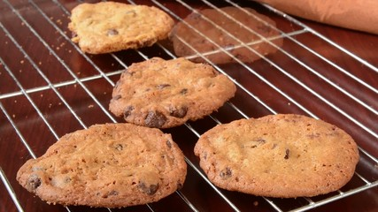 Fresh baked cookies vanishing from a cooling rack