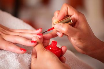 Applying nail polish, hands closeup