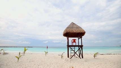 Lifeguard tower on caribbean beach in bad weather, Cancun, Mexic