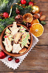 Gingerbread cookies in bowl with Christmas decoration
