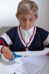 Kid holding scissors